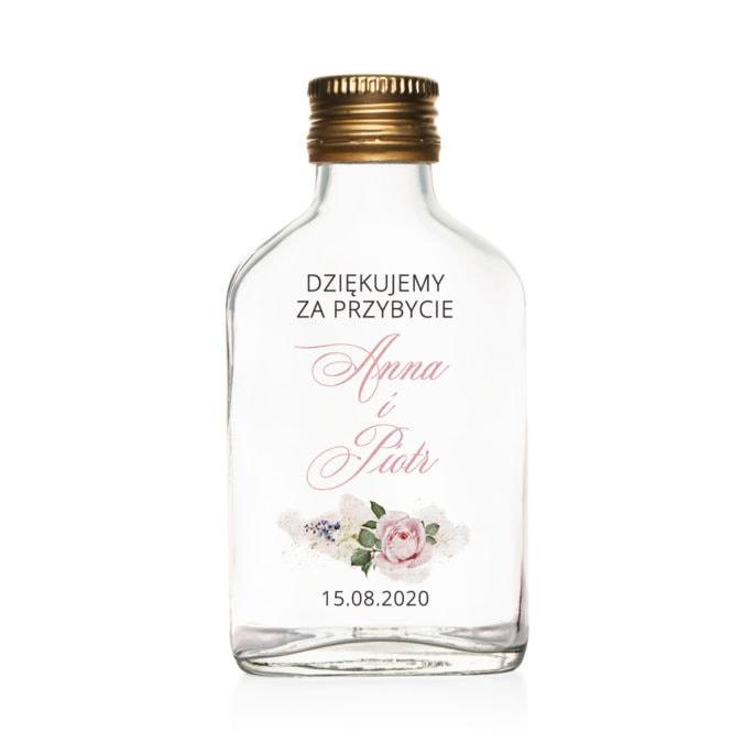 Podziękowanie dla gości weselnych szklana butelka kacówka na nalewkę z różowymi kwiatami